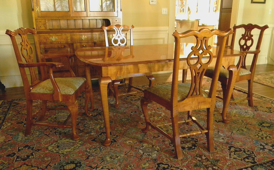 Chippendale Style Table and Chairs, curly maple. The chairs are built in the Massachusetts Chippendale style with the unique owl pattern in the splat. The legs of the table are chippendale but the design of the table is built for today's needs, expanding on slides to accept 2 leaves.